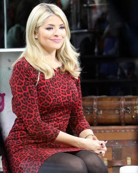 Holly Willoughby poured her famous curves into a red leopard print dress