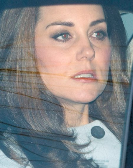 Prince George's pregnant mum looked tense as she made her way to the venue