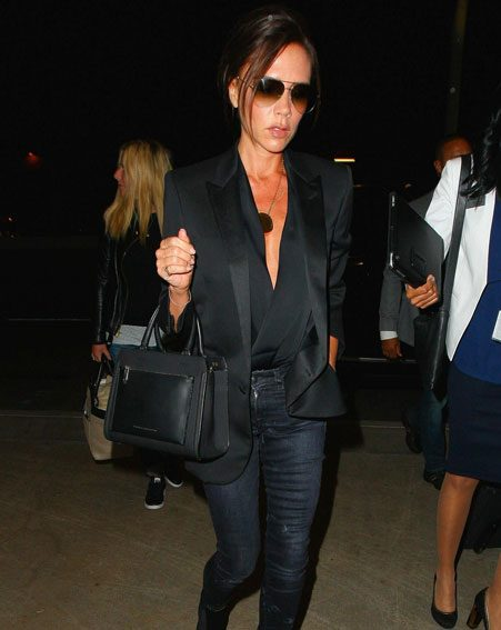Victoria looked as stylish as ever before her 10 hour flight out of LA