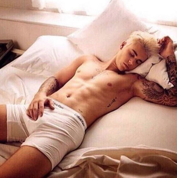 The singer posed in bed in just his Calvin Klein underwear