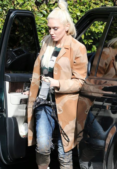 Gwen added a camouflage coat and wedge trainer to finish her look