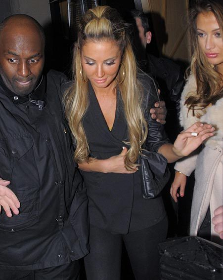 Tulisa attempted to cover up her fashion mishap with her blazer