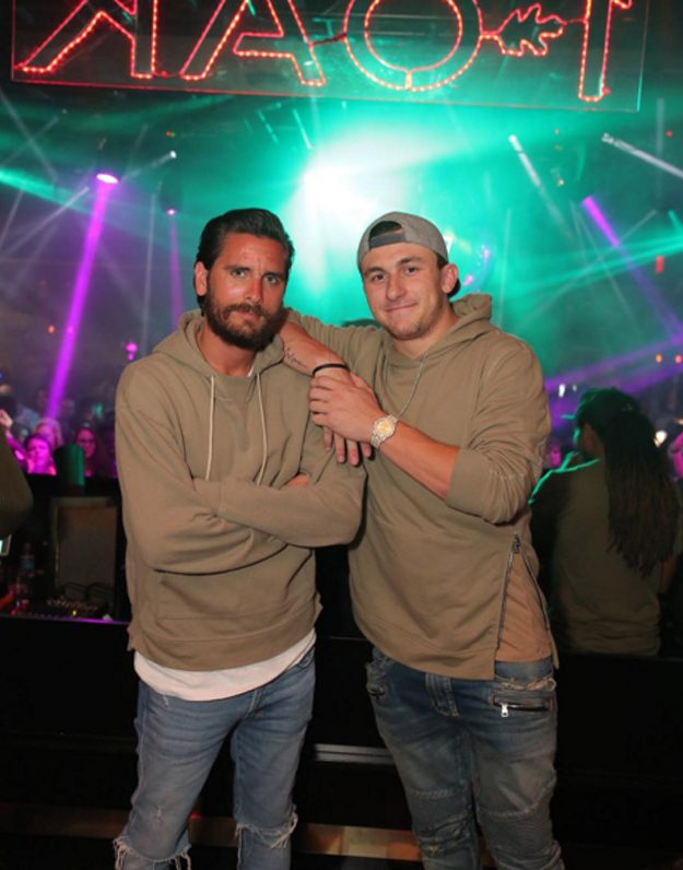 Scott Disick was pictured partying in 1OAK Las Vegas with Jonny Manziel the night Kourtney posted the image of her children