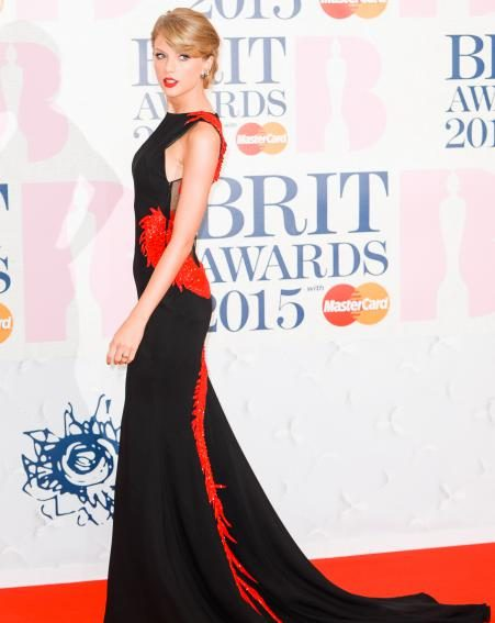 Taylor Swift looks stunning in this elegant black and red number at the 2015 Brits