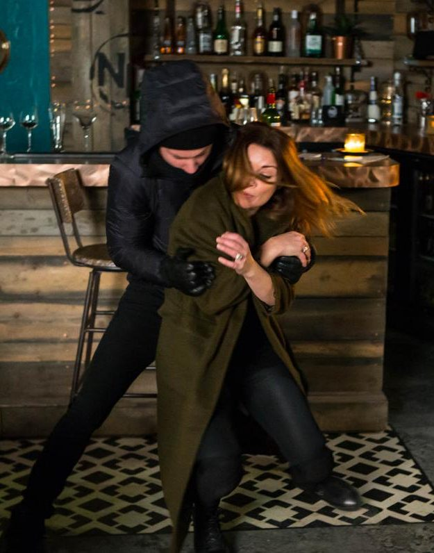 The burglars attempt to take Carla's bag