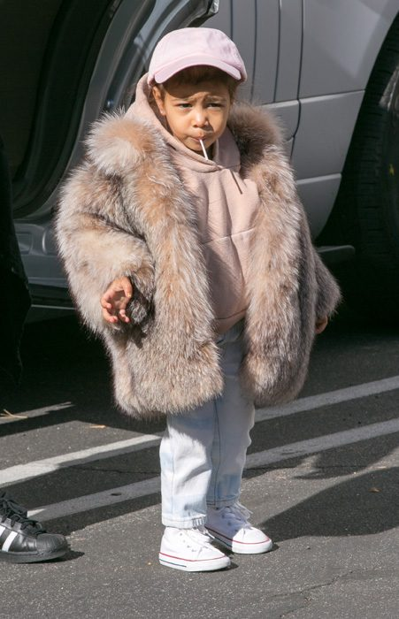 Fans were undecided over North's fur jacket with some saying she looked cute
