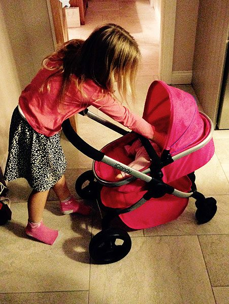 Freya looking after her 'baby' dolls with her 'mini me' pram!