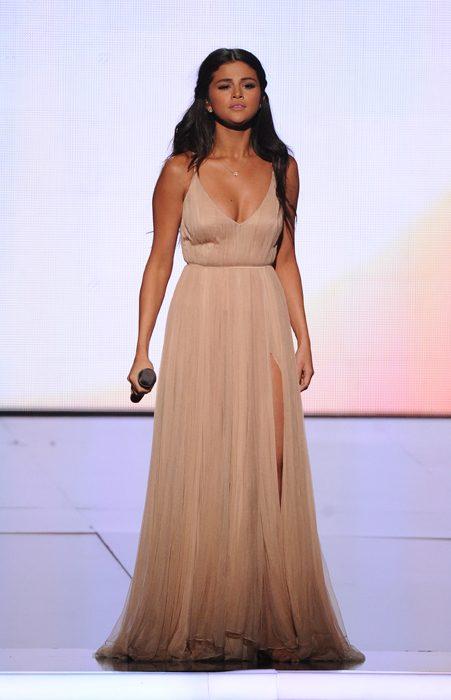 Selena looked stunning in a nude Giorgio Armarni dress