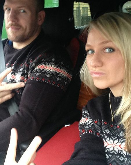 Matching Christmas jumpers all day because he lost a bet