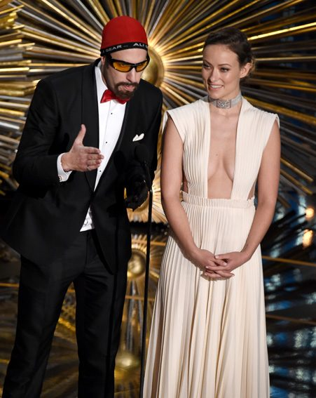 Sacha Baron Cohen joined Olivia Wilde on stage at the Oscars 2016
