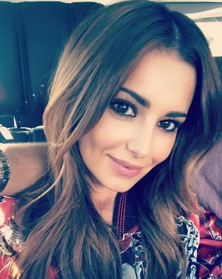 Is that a famous arm we recognise? The pair continue to tease us on their rumoured relationship as Liam's arm wraps around Cheryl