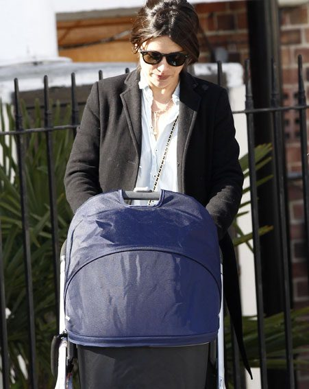 Amelia looked stylish as she pushed a pram in London