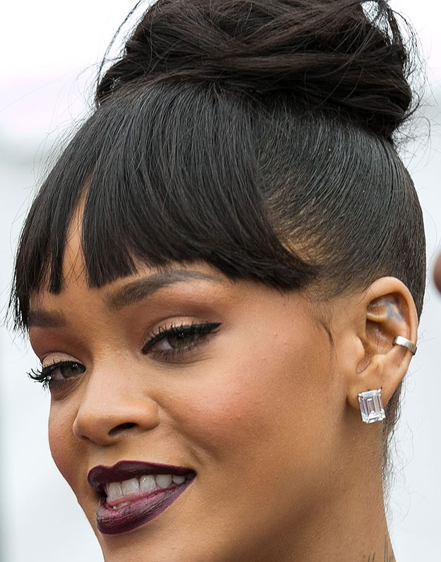 Only Rihanna would think to get a tattoo on the top of her ear